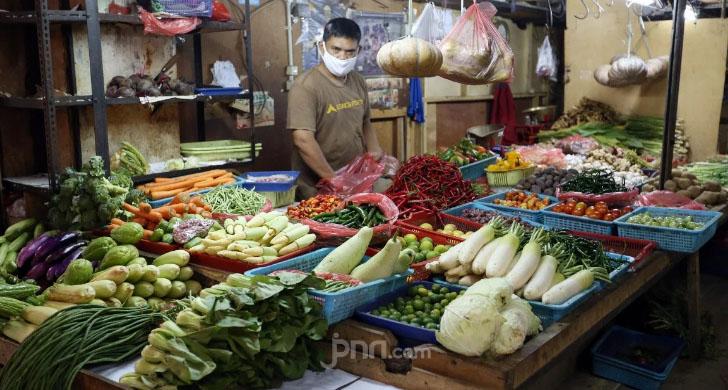 Pedagang di pasar tradisional. Ilustrasi Foto: Ricardo/JPNN.com