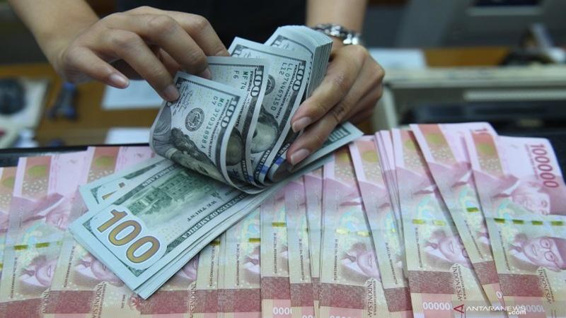 Kurs tengah BI pada 11 November 2019 menjadi Rp 14.040/USD (foto: Antara)