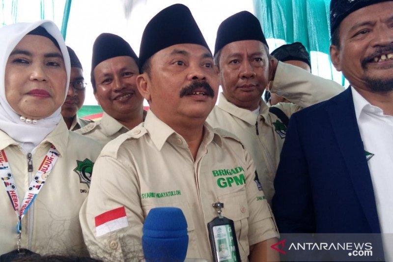Ketua Gerakan Persaudaraan Muslim Indonesia (GPMI) DKI Jakarta Raya Syarief Hidayatulloh (tengah) di Jakarta, Minggu (16/2/2020). (Foto: Antara/Devi Nindy)