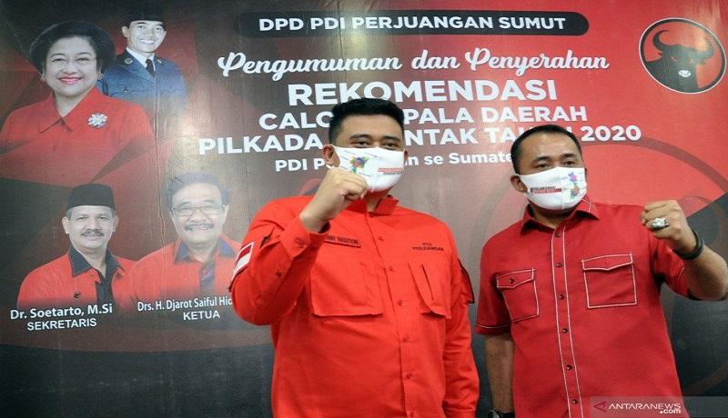 Pasangan Bobby Nasution-Aulia Rachman. FOTO: Antara