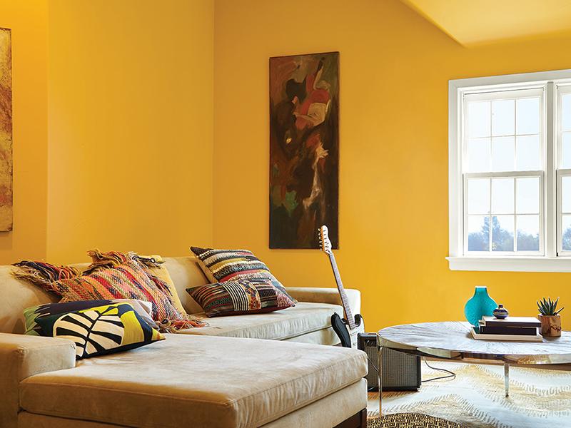 Ilustrasi ruangan dengan cat tembok warna kuning yang melambangkan keceriaan. Foto: Behr Canada