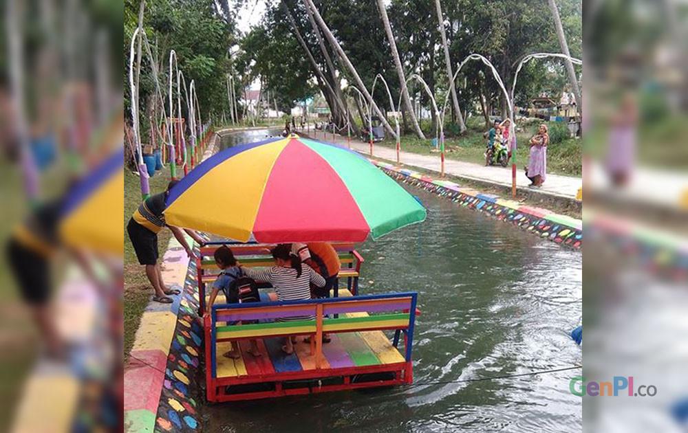 Wisata air di saluran irigasi Talulobutu, Bone Bolango.